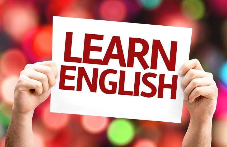 Learn English card with colorful background with defocused lights.jpeg