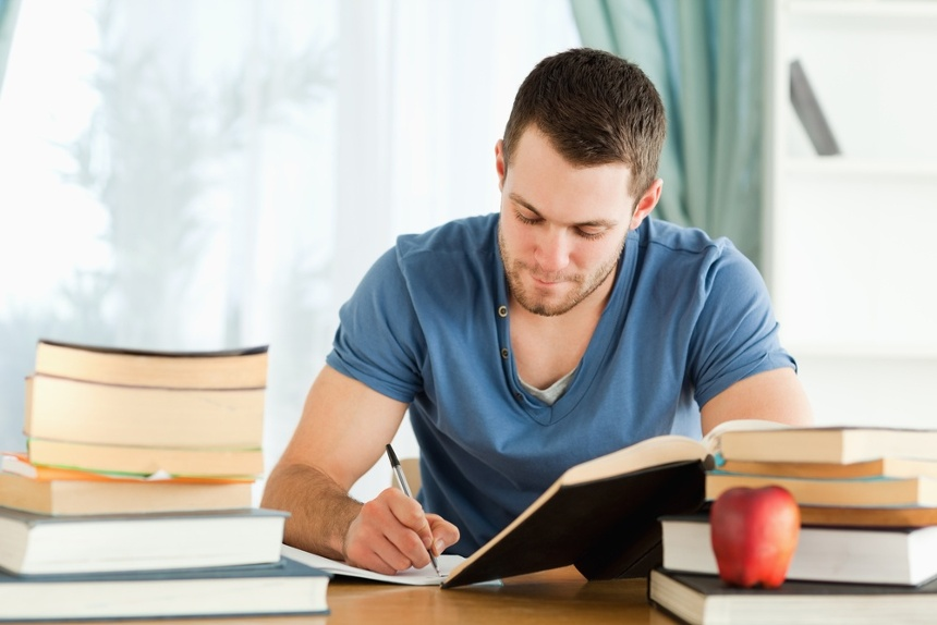 Male student working through his books-1.jpeg