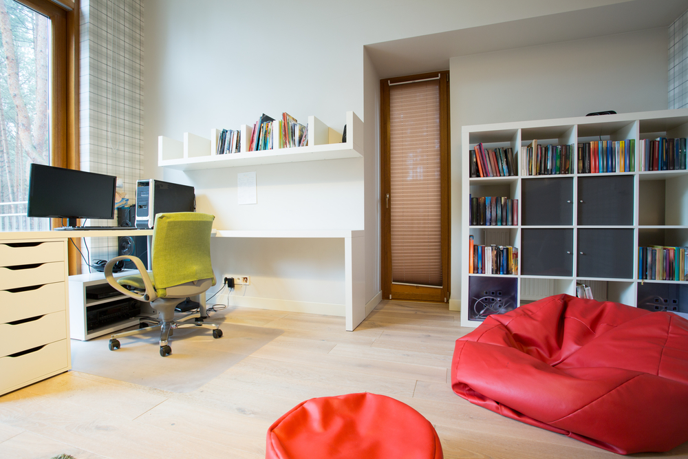 Modern spacious study room with red bag chair